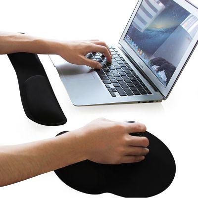 ergonomic mouse pad black next to laptop