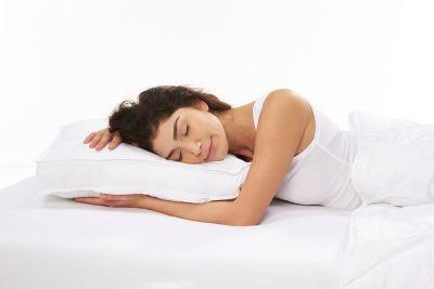 ergolution premium pillow with model sleeping on it