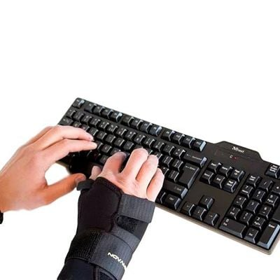 novamed thumb support wrist splint in use on keyboard